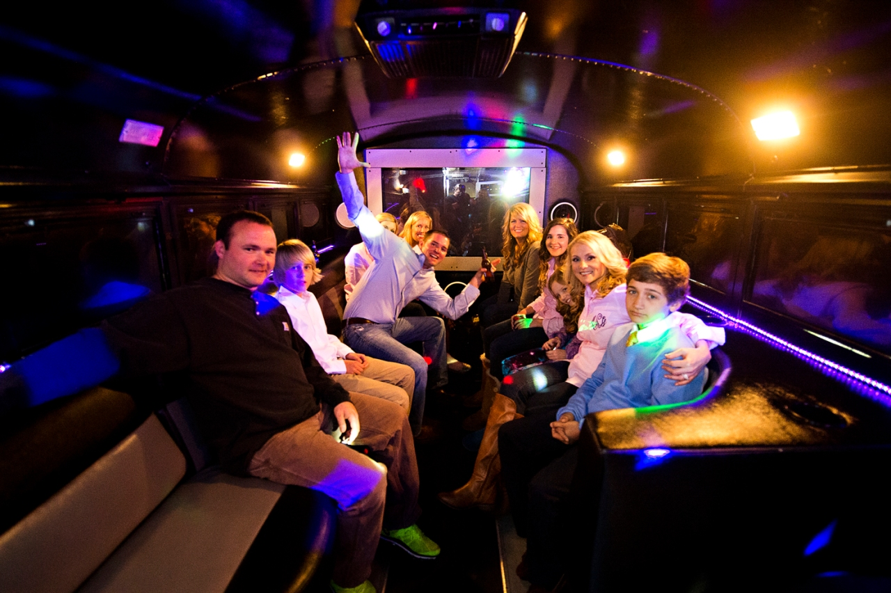 On the party bus at the end.